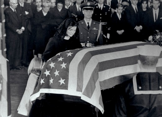 Jacqueline Bouvier Kennedy and Daughter Caroline at John F. Kennedy's Coffin